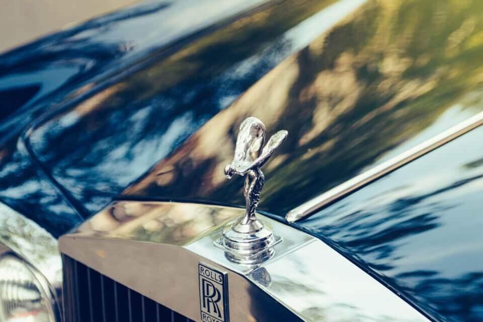 alquiler coches clasicos ingleses de lujo bodas eventos rodajes jjdluxe cars alicante murcia coleccion rolls royce logo